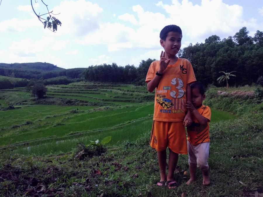 Kids near a rice paddy on a detour between Quang Ngai and Da Nang