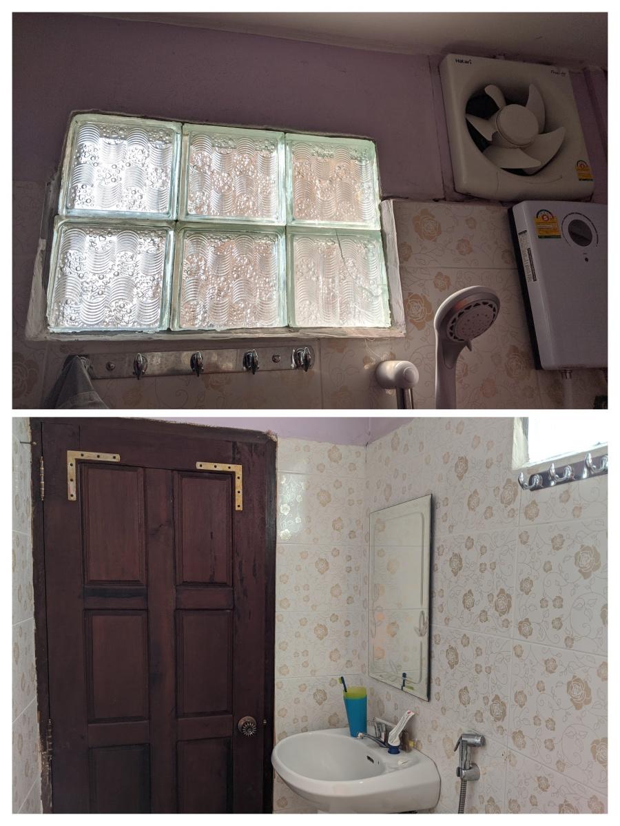 The bathroom door, window, and fan