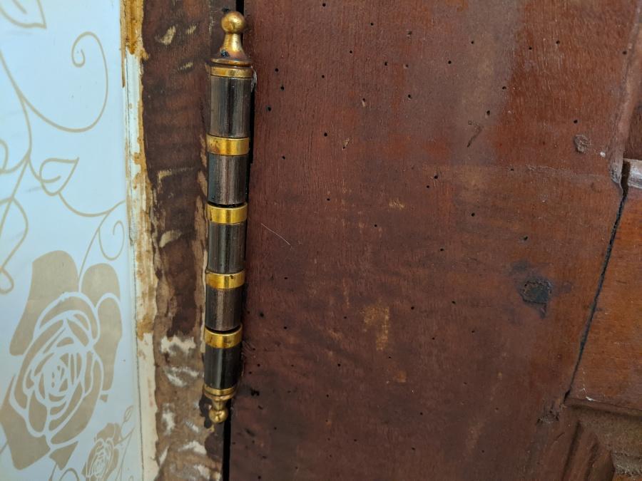 One of the door hinges