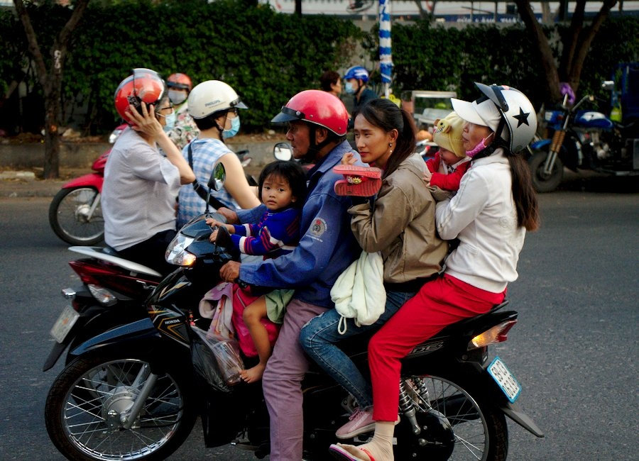 A Family of Five on a Scooter in Saigon